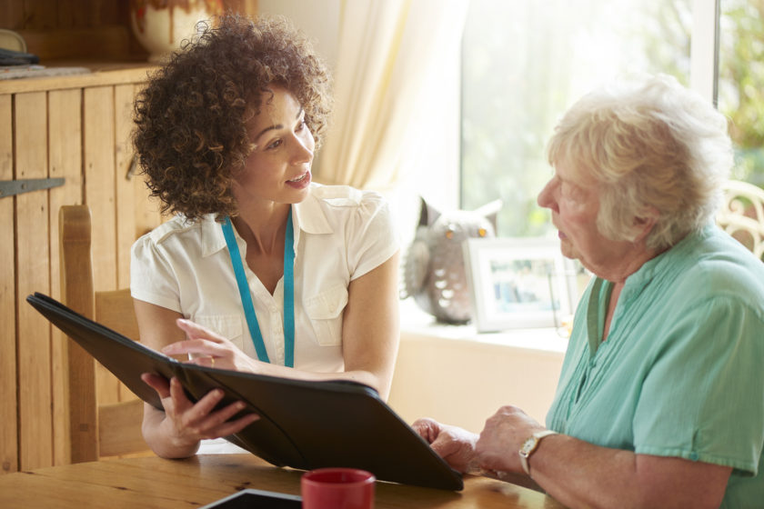 medical professional or housing officer makes a house call to a senior client at her home . She is discussing the senior woman's options on her digital tablet. Connecting with Your Patients