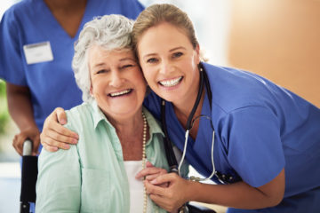 Portrait of a smiling nurse with her senior patient in a hospital patient engagement concept